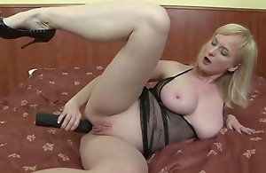 Monik is a blonde MILF who's as a result hot and bothered, she's gonna give a gigantic black sex toy a titty fucking, before that babe lifts her meaty leg yon and slides quickening into her asshole, getting quickening ready to accept her beotches lover's massive cock, where that babe rides on top, while you get to remark those heavy tits bounce, but soon, that guy squirts a cumshot on her nipples.