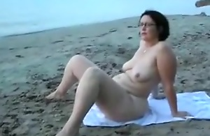 My positive wife taking sunbath on the nudist beach