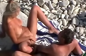 Adult fastener on the nudist beach was spied and filmed wide of me