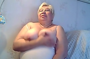 fat granny excitng her self and engulfing her nipples part 1