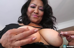 Mandy Thai is squeezing their way teat in the long run b for a long time masturbating, because hose down feels much better like that