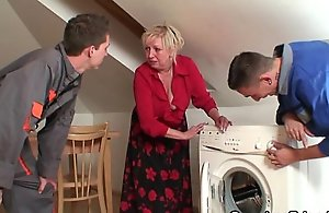 Two repairmen bang well-endowed grandma from the one increased by the other ends