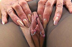 English gilf Pandora bonks her pantyhosed bawdy cleft with a dildo